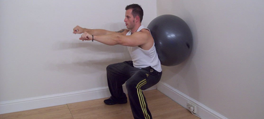 wide_fitness_ball_wall_squats_finishing