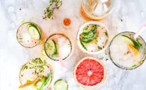 Grapfruit and different kinds of grapefruit juices on ice, in a quest to find out if grapefruit burns fat.