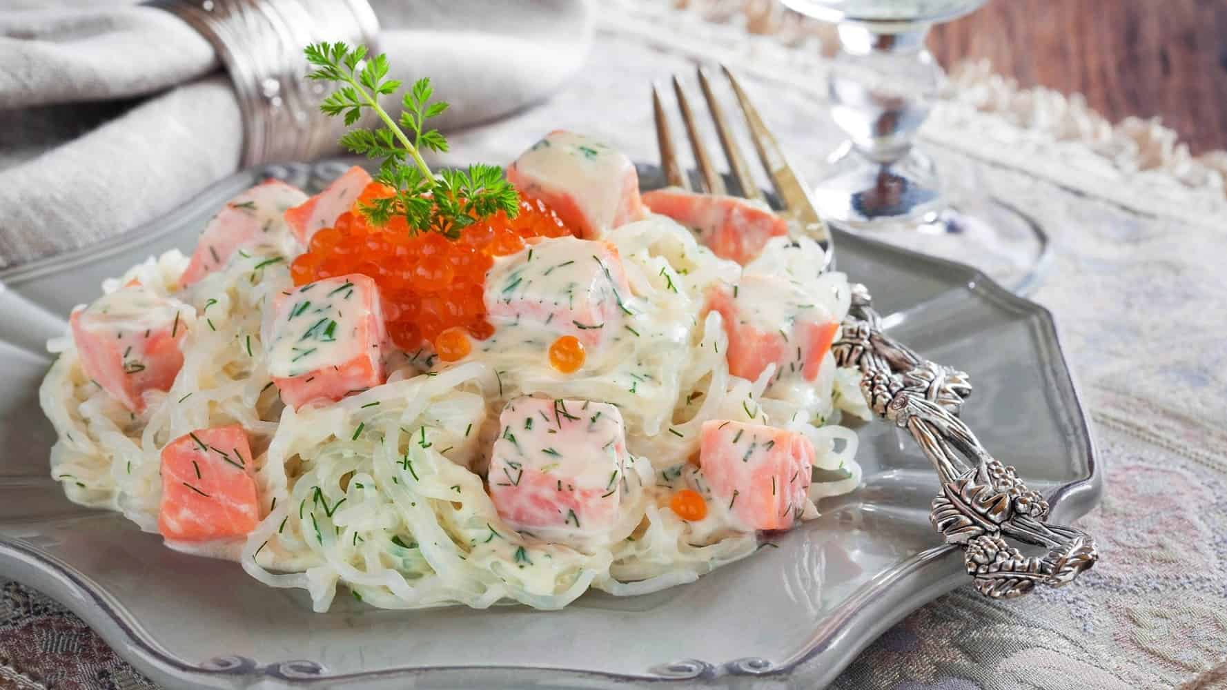 A plate of shirataki noodles with salmon.