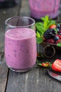 A glass of purple juice.