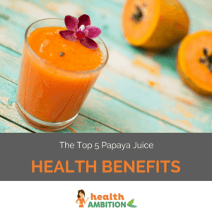 """A glass of papaya juice with a flower decoration next to halved papayas with the title """"The Top 5 Papaya Juice Health Benefits."""""""