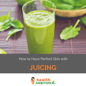 """A glass of green juice with leaves in the background with the title """"How to Have Perfect Skin with Juicing."""""""