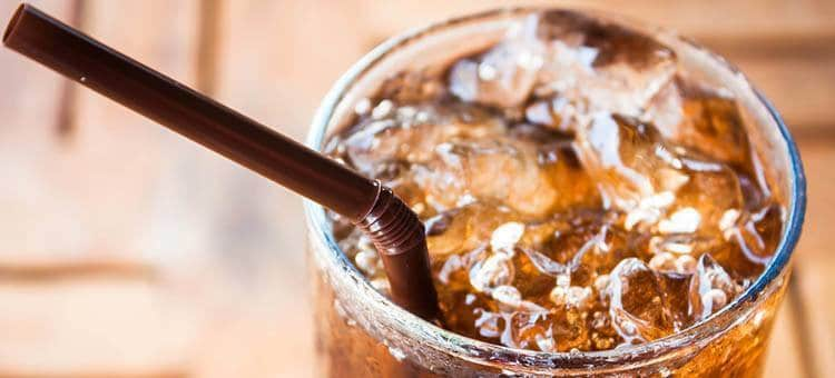 A glass of soda with ice.