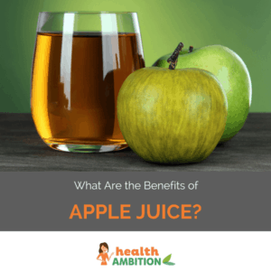 """Glass of apple juice next to apple with the title """"What Are the Benefits of Apple Juice?"""""""