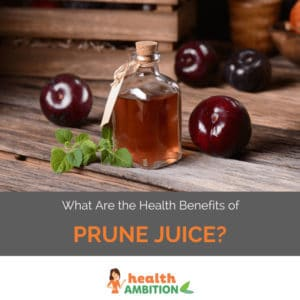 """A bottle of prune juice with prunes with the title """"What Are the Health Benefits of Prune Juice?"""""""